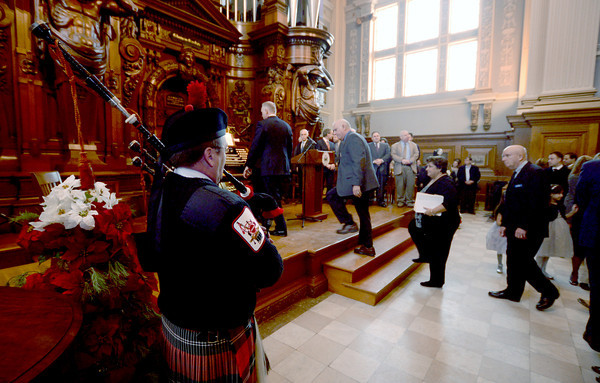 Methuen: Firefighter Bob Morris plays bagpipes as city officials make their way to the stage for the 2014 Inauguration at The Methuen Memorial Music Hall Saturday morning. Jim Vaiknoras/staff photo