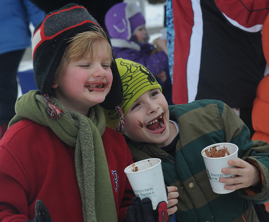 newburyport: Ollie Low, 7, and Decklan Hechheiser, 6, enjoy hot coco at the Winter Carnival at the Bartlet Mall Saturday in Newburyport. Jim Vaiknoras/staff photo