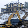 Newburyport: Heavy equiptment moves large boulders in front of the Bennet Hill House on Plum Island. Jim Vaiknoras/staff photo