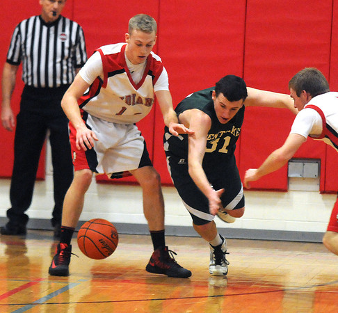 Amesbury: Amesbury's Jack Fortin fights for a loose ball with Pentucket's Pat Freiermuth during their game at Amesbury high Friday night. Jim Vaiknoras/staff photo
