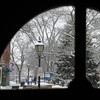 Newburyport: Downtown Newburyport fills with snow as seem through a fan window at the door of the Thirsty Whale on State Street. Jim Vaiknoras/staff photo