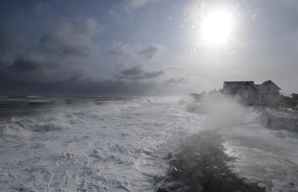 Newbury: Waves pound the shore off Plum Island Friday morning. Jim Vaiknoras/staff photo