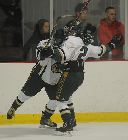 Haverhill: Pentucket's Braydon carney hugs teammate Cam Wolbach after Wolbach's first period goal against North Reading at Veteran Memorial Rink in Haverhill Saturday night. jim Vaiknoras/staff photo