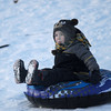 Londonderry: Carter Libert,3, of Merrimac NH gets some sledding it while waiting for the 19th annual bonfire at Mack's Apples in Londonderry Saturday night.Jim Vaiknoras/staff photo