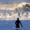 Newbury: A surfer attempts to head out into the high surf off Plum Island Friday afternoon. Despite repeated attempts the surfer found the waves too knarley to allow him to get past the breakers. Jim Vaiknoras/staff photo