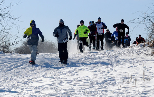 Amesbury: A snowshoers take off  Amesbury Sunday morningin the cold on Woodsom Farm in Amesbury at the first Amesbury Police Chase Snowshoe Fun Race. JIm Vaiknoras/staff photo