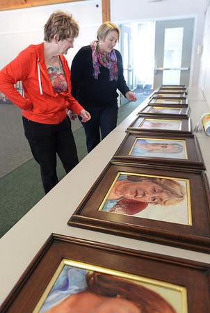 BRYAN EATON/Staff Photo. Merrimac artist Mary Pyche, left, looks over the work of fellow artist Elizabeth Peck.