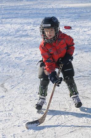 Jim Vaiknoras/staff photo Ryan Carner, 5, of Newbury plays hockey on the Upper Green in Newbury Friday afternoon.