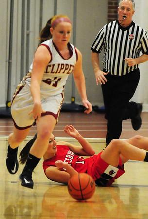 BRYAN EATON/ Staff Photo. Amesbury's Amanda Martin hits the floor as Newburyport's Shelby O'Brien gets control of the ball.