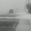 BRYAN EATON/Staff Photo. Strong winds created drifting along the Plum Island Turnpike.