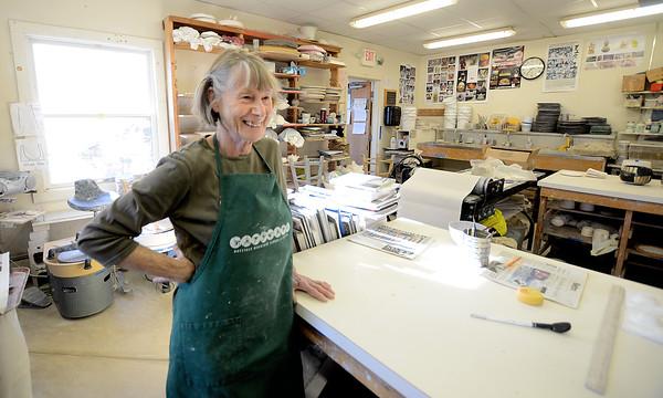 JIM VAIKNORTAS/Staff photo Ceramics artist Irina Okula in her classroom at the Governor Academy.