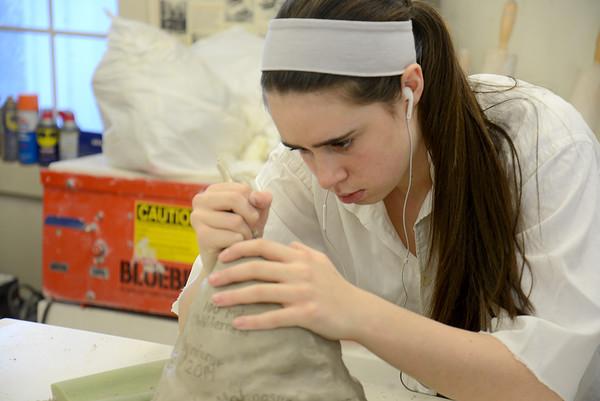 JIM VAIKNORTAS/Staff photo Hayden Valas works on her peice in  Irina Okula ceramics class at the Governors Academy.
