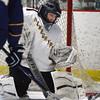 BRYAN EATON/Staff Photo. Newburyport goalie Noah Kolesha stops the puck last night at the Graf Rink.