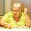 JIM VAIKNORAS/Staff photo Dale Kent plays 24 cards during a game of bingo at the Newburyport Senior Center.