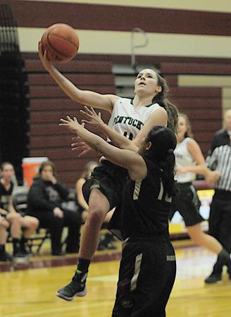 JIM VAIKNORAS/Staff photo Pentucket's Katie Giusti with a shot on net at Whittier Thursday night.