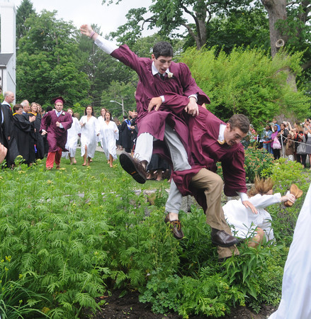 Byfield: Graduates jump the wall, a tradition at the Governor's Academy Commencement. . Jim Vaiknoras/Staff photo