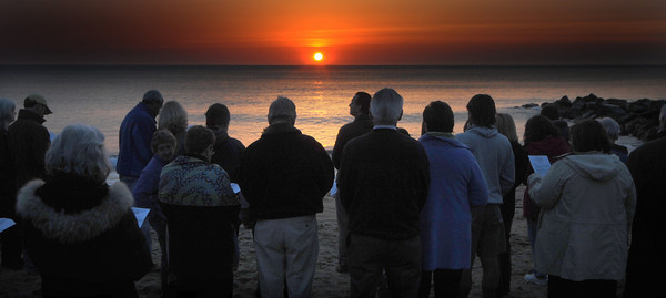 Newbury: Members of the Central Congregational Church, The Belleville Congregational Church, and the First Parish Church Newbury gather to sing , pray and greet the Easter dawn on Plum Island Sunday. Jim Vaiknoras/Staff photo
