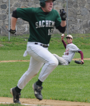 Newburyport:Newburyport's  Joe Clancy  tries to throw out Pentucket's ... Shipps from a prone position Saturday at the Lower Field.<br /> Photo by Jim Vaiknoras/Newburyport Daily News Saturday, May 17, 2008