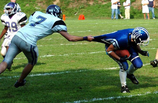 Georgetown:Georgetown's Anthony Conte tries to get away from Shawsheen Shawn Donovan Saturday. Georgetown won the game 21-14.<br /> Photo by Jim Vaiknoras/Newburyport Daily News Saturday, October 06, 2007