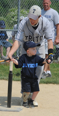 Newbury:Triton baseball player Mike Cerbone helps Teddy Jones  at the Challenger baseball game at Triton Saturday. Approximately 25 special need students played in the game supported by members of the Triton baseball and softball teams.<br /> Photo by Jim Vaiknoras/Newburyport Daily News Saturday, June 14, 2008