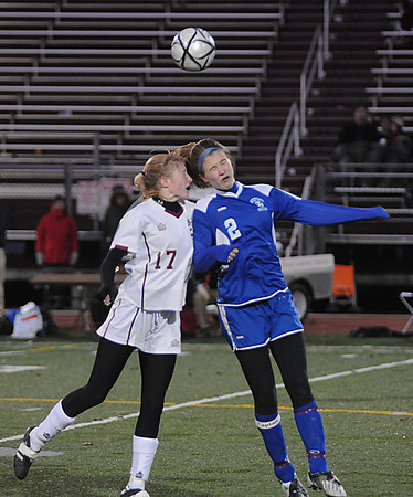Lowell: Avery Cullinan goes up for a header with a Bedford player during  their game  at Crowley Stadium in Lowell. The Clippers beat Bedford 2-1 in OT  giving them their 3rd straight North Sectional Title. photo by Jim Vaiknoras/Newburyport Daily News Sunday November 16, 2008<br /> , Lowell: Avery Cullinan goes up for a header with a Bedford player during  their game  at Crowley Stadium in Lowell. The Clippers beat Bedford 2-1 in OT  giving them their 3rd straight North Sectional Title. photo by Jim Vaiknoras/Newburyport Daily News Sunday November 16, 2008