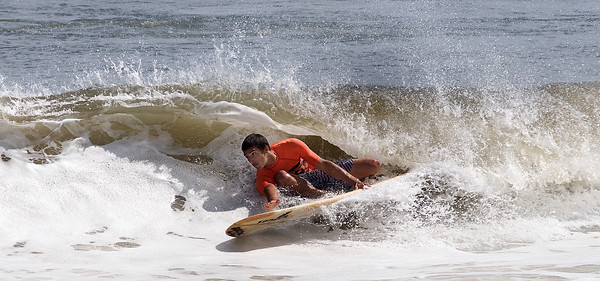 Salisbury: Jared Veltsos gets chased by the curl in the long board contest at the Labor Day Surf Festival and the big competition at Salisbury Center Sunday morning. Jim Vaiknoras/Staff photo