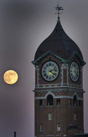 Lawrence:<br /> A full moon raises behind the Ayer Mill Clock late Monday afternoom<br /> Photo by jim Vaiknoras/Eagle-Tribune Monday, December 04, 2006