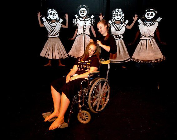 """Newburyport: Amanda Coffin as Ana, in the wheelchair, and Rachel Coffin as Mia in """"The Argument"""" at the Firehouse. With the doll chorus behind them.<br /> Photo by Jim Vaiknoras/Newburyport Daily News. Sunday, June 10, 2007"""