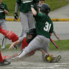 West Newbury: <br /> Masco catcher Christine Rossi just misses the tag as Pentucket's Paige Sutherland scores.<br /> Photo by Jim Vaiknoras/Newburyport Daily News. Friday, May 6, 2005