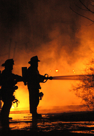 Amesbury: <br /> Firefighters battle the barn fire on Newton Rd last night. <br /> Photo by Jim Vaiknoras/Newburyport Daily News. Sunday, March 28, 2004