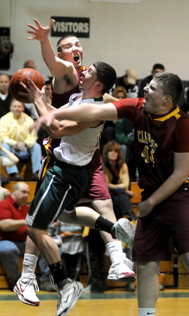 West Newbury: Pentucket's Jordan Silva goes up for a lay up between Newburyport's Nicholas Welch and Patrick Reynolds during their game at Pentucket Friday night. photo by Jim Vaiknoras/ Newburyport Daily News. February 6 2009<br /> rchive, West Newbury: Pentucket's Jordan Silva goes up for a lay up between Newburyport's Nicholas Welch and Patrick Reynolds during their game at Pentucket Friday night. photo by Jim Vaiknoras/ Newburyport Daily News. February 6 2009<br /> rchive