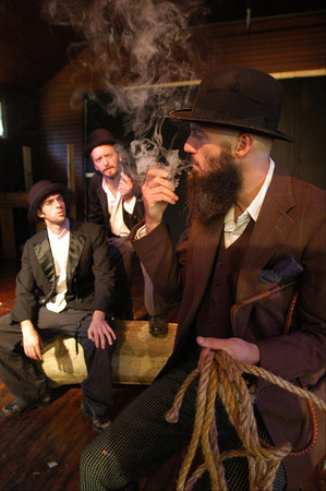 """Newburyport: <br /> From the left: Dylan Fuller as Estragon, Chris Curtis as Vladimir and smoking the pipe is Damon Jespersen as Pozzo in the Thearer in the Open production of """"Waiting for Godot""""<br /> Photo by Jim Vaiknoras/Newburyport Daily News. Saturday, September 3, 2005"""