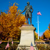 Newburyport: The statue of George Washington on the Bartlett Mall in Newburyport stands out amonst a riot of autumn colors on a clear morning last week. Jim Vaiknoras/Staff photo