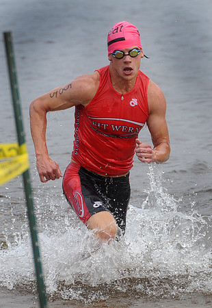 Amesbury: Peter Mallet burst out of the water at the Amesbury Dam Triathlon at Lake Gardner in Amesbury Saturday morning. Jim Vaiknoras/Staff photo
