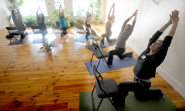 Newburyport: Yoga intructors , from left, Barbara Cross, Rose Russo, cathy Allen, Rene LeVerrier, Roberta Dell'Anno, Leigh Snow and Terry Schaff, partictpate in a class lead by LeVerrier on teaching yoga to people with Parkinson's. Jim Vaiknoras/Staff photo