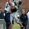West Newbury: <br /> Pentucket's Tom Beaton knocks the ball away from Wilmington's Joe Mayo in the first half of Saturday's game.<br /> Photo by Jim Vaiknoras/Newburyport Daily News. Saturday, October 23, 2004