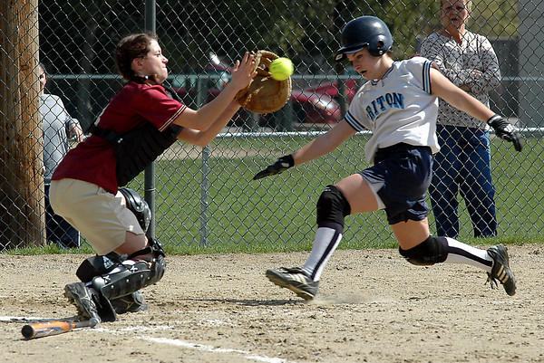 Newburyport: <br /> Newburyport catcher Christina Kelly handles a throw before tagging out Triton's Heather Levesque at the plate<br /> Photo by Jim Vaiknoras/Newburyport Daily News. Monday, April 19, 2004