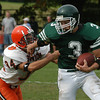 West Newbury: <br /> Pentucket's Aaron McCraine stiff arms Ipswich's  Franklin Pike Saturday. <br /> Photo by Jim Vaiknoras/Newburyport Daily News. Saturday, October 9, 2004