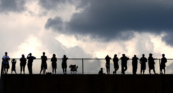 Newburyport: Spectator get a elevated view of the Newburyport high baseball game Saturday from the top of the football stadium. Dispite the dark clouds the weather held as did the Clippers as they beat Ipswich 10-6. Jim Vaiknoras/Staff photo<br /> , Newburyport: Spectator get a elevated view of the Newburyport high baseball game Saturday from the top of the football stadium. Dispite the dark clouds the weather held as did the Clippers as they beat Ipswich 10-6. Jim Vaiknoras/Staff photo