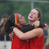 Worchester: <br /> Talia Mondalto , left concoles teammate Kate Corrigan after the teams loss to Turner Falls Saturday.<br /> Photo by Jim Vaiknoras/Newburyport Daily News. Saturday, June 18, 2005