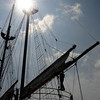 Salisbury: The sun shines behing the masts of the Peacemaker at the Merrimack River Maritime Festival Saturday at Salisbury Beach Reservation.   Jim Vaiknoras/Staff photo