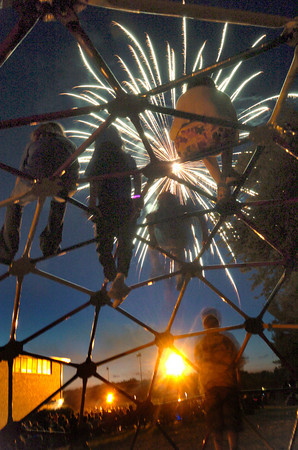 North Andover:Kids sit on top of playground equipment  at the Atkinson School as they watch the North Andover fireworks Saturday night.<br /> Photo by Jim Vaiknoras/Eagle-Tribune Saturday, June 30, 2007