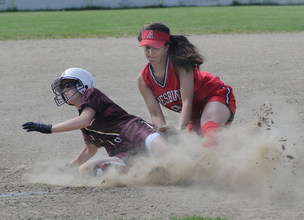 Other:Amesbury's Laura Kaminski is late with a tag as a Concord player slides into 3rd during the Indians 7-6 extra inning win over Concord Carlisle Sunday in Concord.<br /> Photo by Jim Vaiknoras/Newburyport Daily News Sunday, June 01, 2008