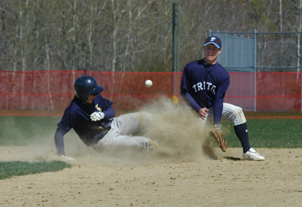 Byfield: <br /> A Lynnfield player slides safely into 2nd as Coby Thibault trys to field the ball in a cloud of dust.<br /> Photo by Jim Vaiknoras/Newburyport Daily News. Sunday, April 30, 2006