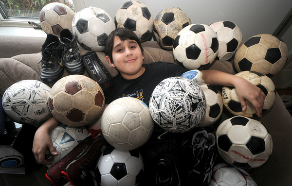 West Newbury: Matthew Crawford, 12,  of West Newbury with some of the soccer equeptment he is bring with him to Africa. Jim Vaiknoras/Staff photo