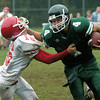 West Newbury: <br /> Pentucket's  Liam Crawford stiff arms Amesbury's Jared Flanagan Saturday afternoon.<br /> Photo by Jim Vaiknoras/Newburyport Daily News. Saturday, September 23, 2006