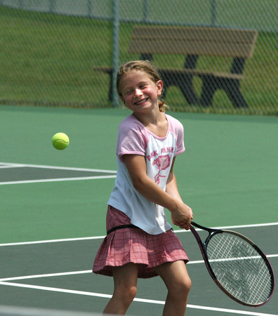 Windham:<br /> Victoria Williams, 6, of Hampstead, NH gets ready hit the ball back to her dad during a game of tennis at Griffin Park in Windham Sunday afternoon. Despite getting  there early in the day, Victoria was still sweating after playing a short time in the summer heat.<br /> Photo by jim Vaiknoras/Eagle-Tribune Sunday, July 16, 2006