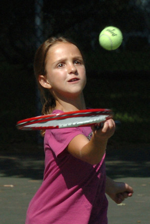 Newburyport: Sasha Leydon, 7, practices her backhand tennis skills at Atkinson Common on Tuesday morning. She was taking lessons with the Newburyport Youth Services Summer Program. Bryan Eaton/Staff Photo