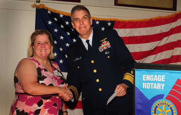 Newburyport: US Coast Guard Rear Admiral Daniel B. Abel receives a check from past Rotary President Liz Jutras at their luncheon yesterday. Bryan Eaton/Staff Photo