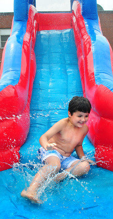 Salisbury: Andrew Stubbs, 6, of Merrimac at the end of the water slide children were cooling off on at the Boys and Girls Club in Salisbury on Thursday afternoon. Bryan Eaton/Staff Photo
